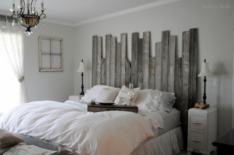 rustic headboard Bedroom Eclectic with barn wood bed tray bedskirt chandelier farmhouse gray walls lamps romantic rustic