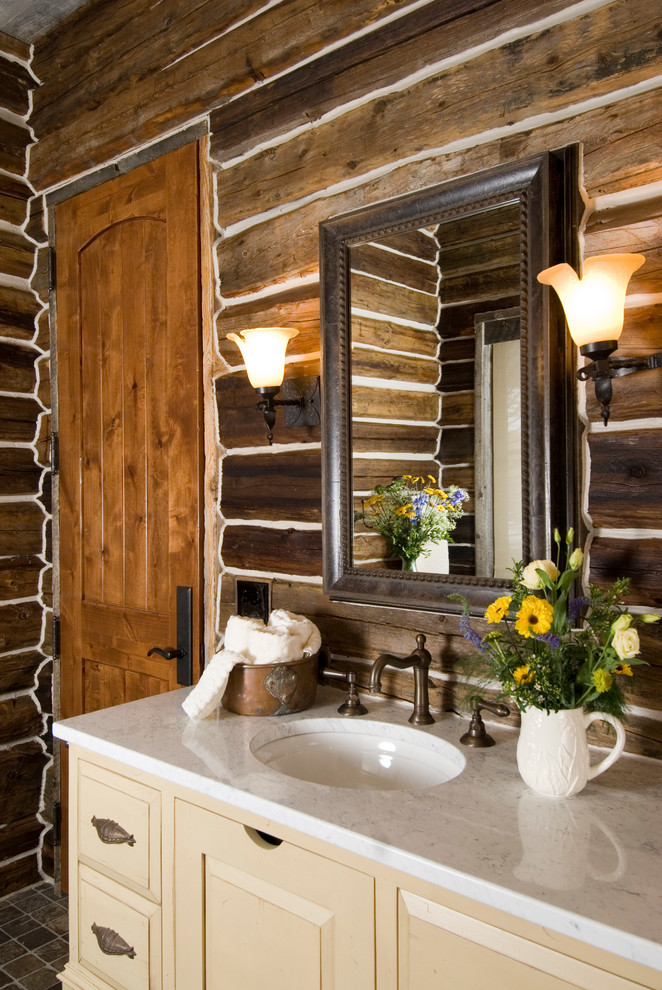 Rustic Wall Sconces Bathroom Rustic with Aged Bronze Faucet Built in Hamper Cream Vanity Log Cabin Marble Counter Mirror