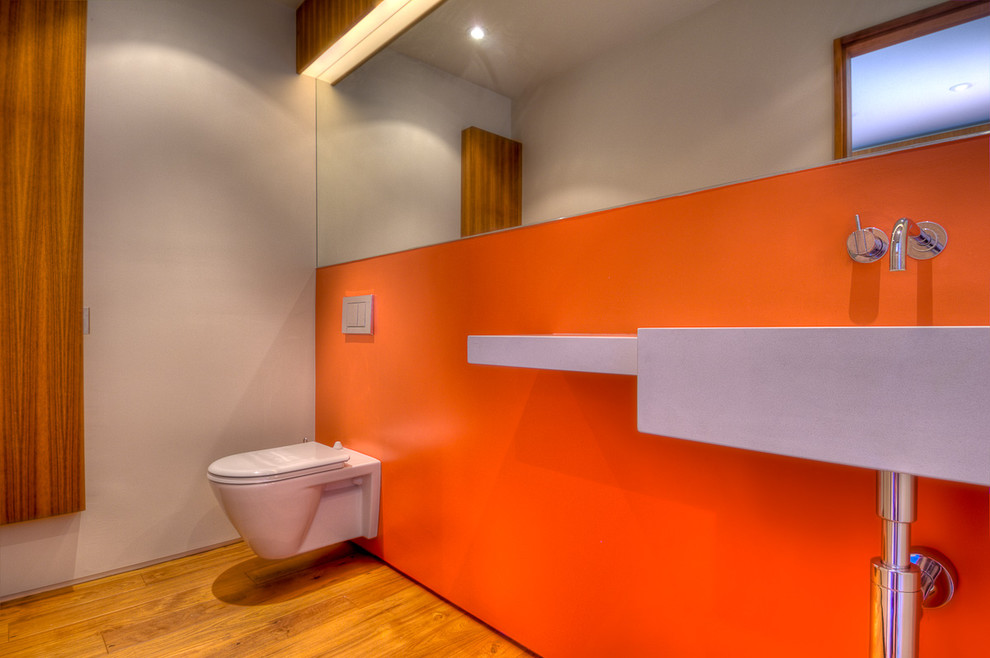 Saniflo Toilet Bathroom Modern with Accent Wall Bathroom Mirror Floating Toilet Minimal Orange Wall Wall Mount Faucet