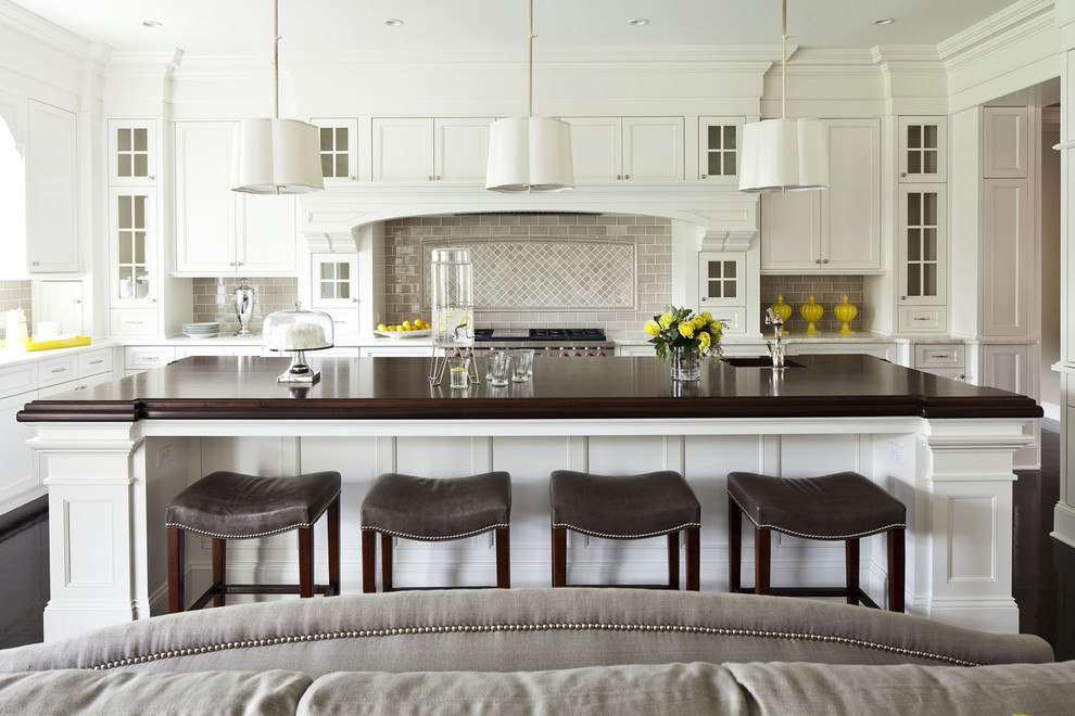 sauder com Kitchen Transitional with black floors brown Cabinetry chandelier dark wood family gray martha o'hara interiors
