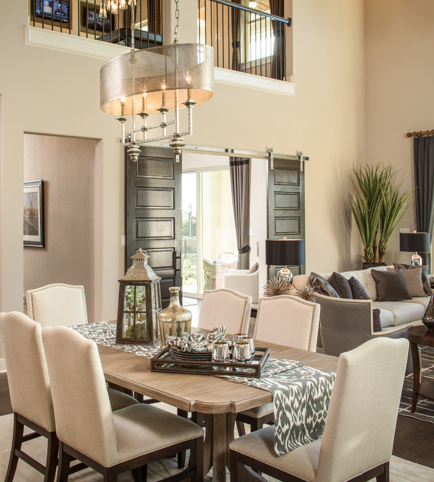 Savoy Lighting Dining Room Transitional with Beige Dining Chairs Chandelier Dining Table Light High Ceiling Nailhead Trim Open