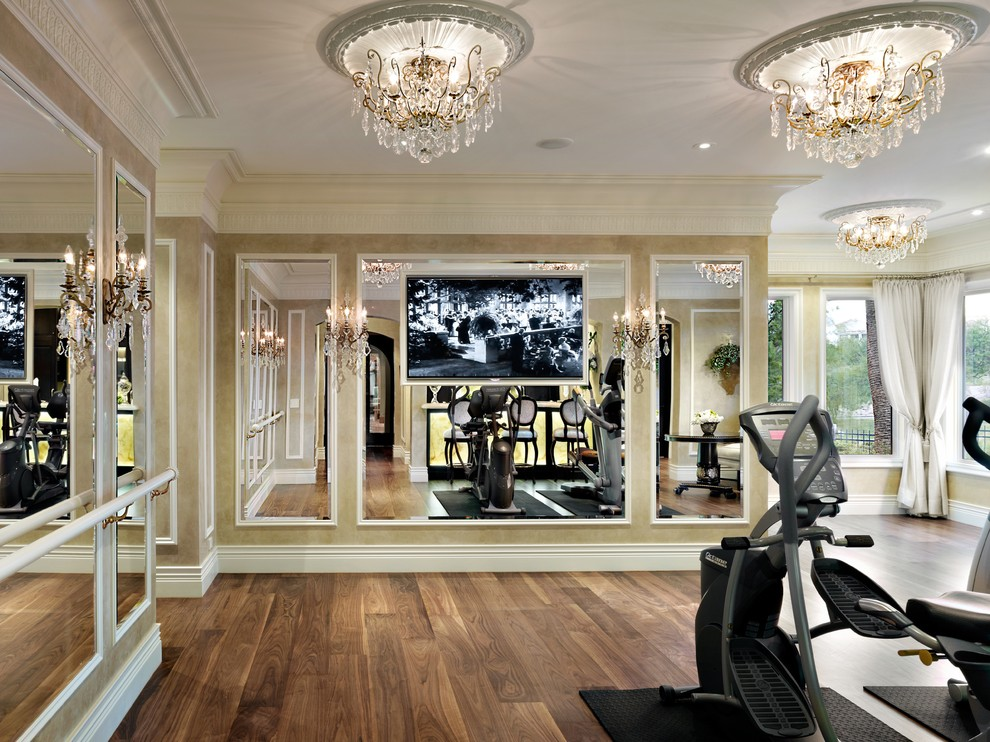 schonbek lighting Home Gym Traditional with chandeliers crown molding mirrored walls neutral colors wall-mounted TV wood floors