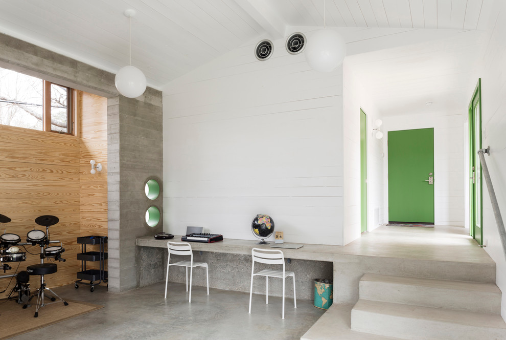 seagull lighting Home Office Contemporary with built-in concrete desk circular cutouts clerestory windows desk chairs green door handrail