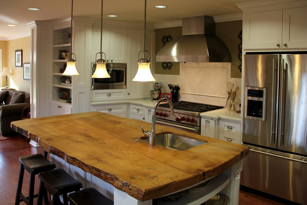 Seagull Lighting Kitchen Traditional with Backsplash Breakfast Bar Built in Butcher Block Countertops Caesarstone Countertops Eat in Kitchen