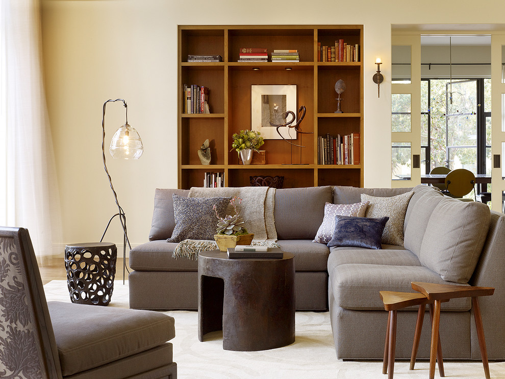 Sectional Sleeper Living Room Transitional with Area Rug Bookcase Bookshelf Bookshelves Built in Corner Sofa Curtains Decorative Pillows Drapes