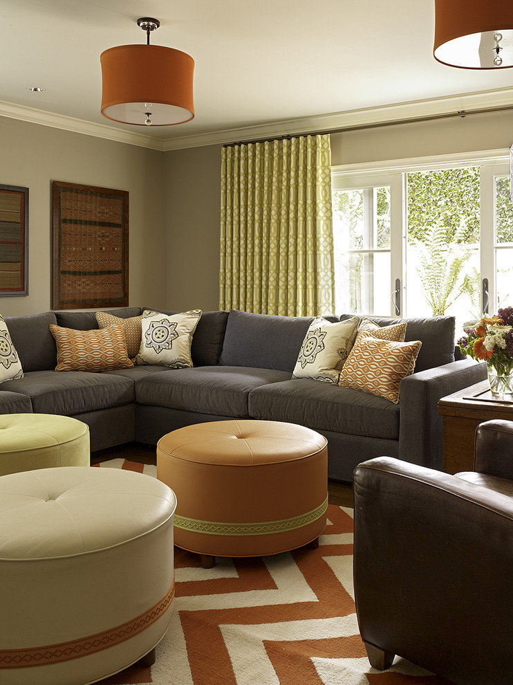 Sectional with Recliner Family Room Transitional with Chevron Crown Molding Decorative Pillows Drum Pendant Gray Sofa Gray Walls Orange