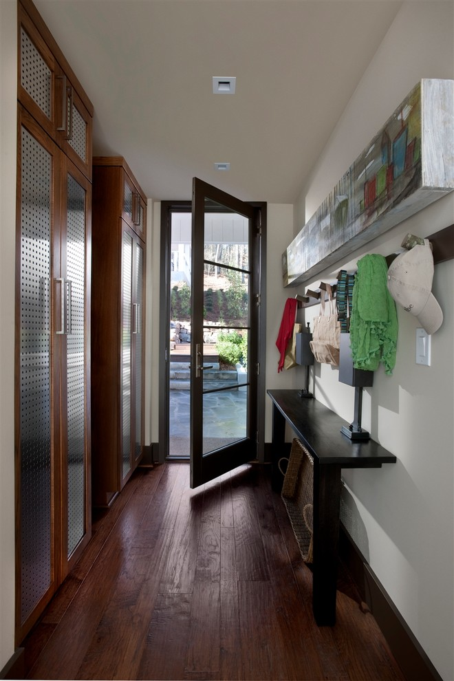 shaw flooring Entry Transitional with Built-In Closets cabinets coat rack console table dark stained wood floor glass