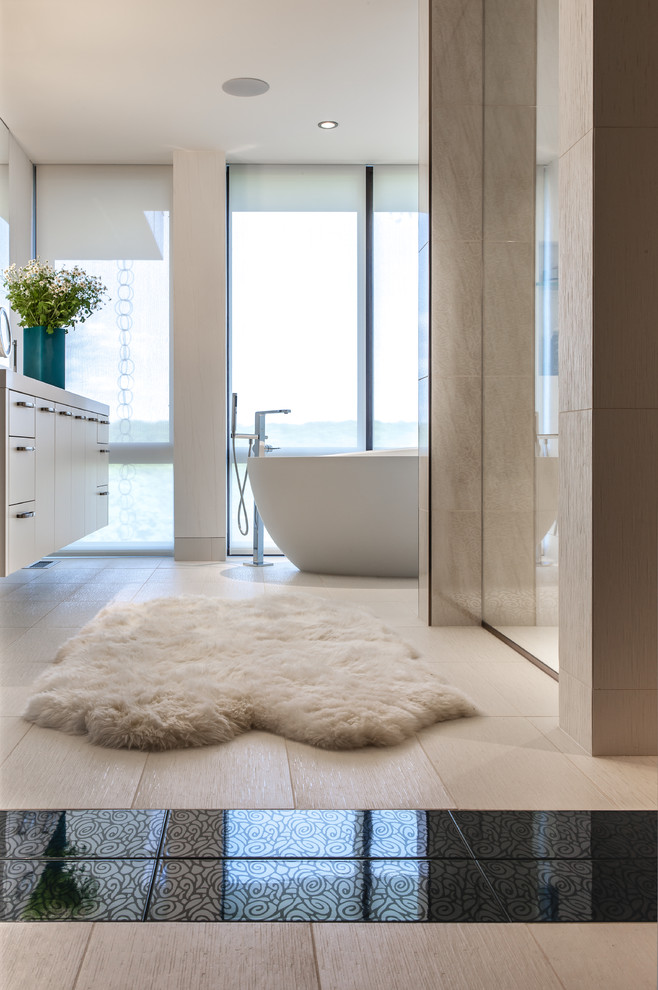 sheepskin rug Bathroom Contemporary with accent tile bath black and white tile egg shaped tub elegant floating