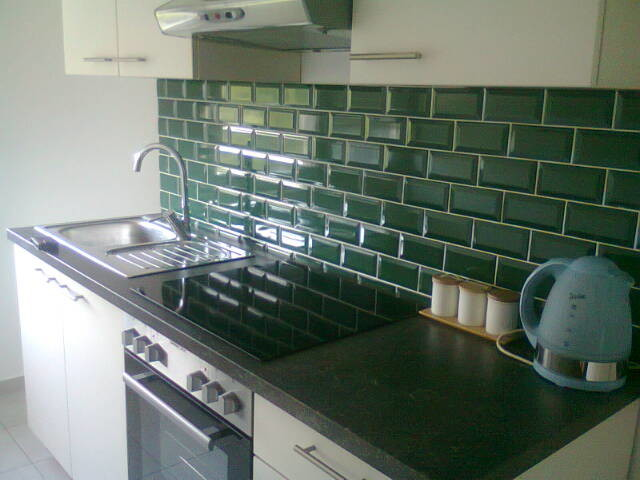 Single Bowl Kitchen Sink Kitchen Traditional with Green Subway Tiles