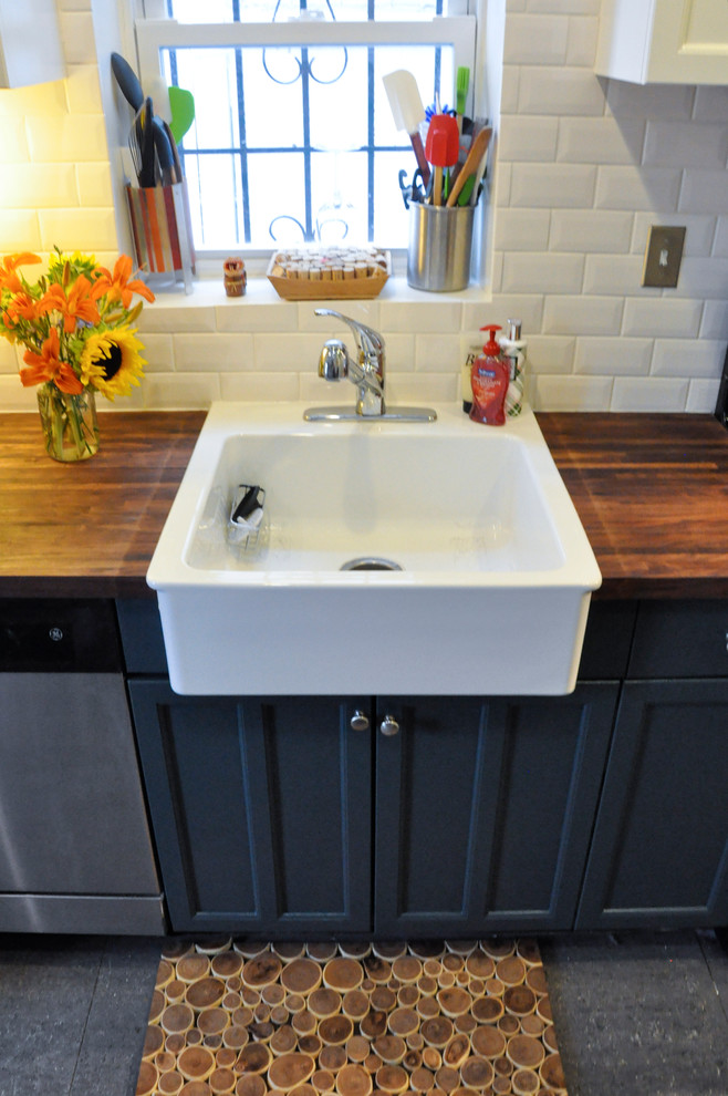 sink base cabinet Kitchen Contemporary with black cabinets branch mat linoleum floor small sink stainless appliances subway tile