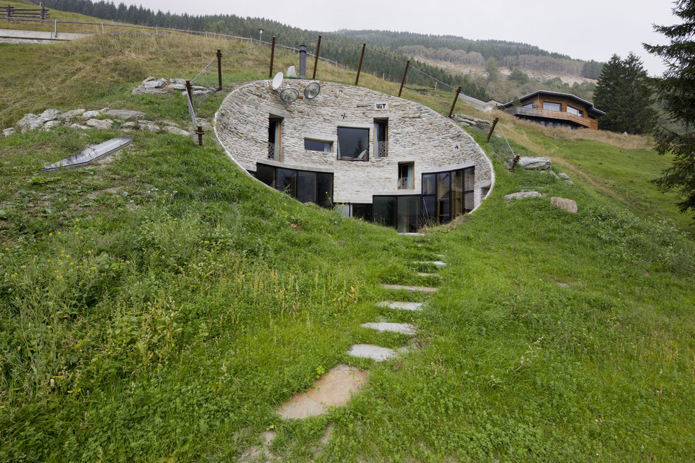 Skywalker Trampoline Reviews Exterior Eclectic with Alpine House Atypical Alpine Architecture Below Ground Home Glass Doors Grass Hillside1