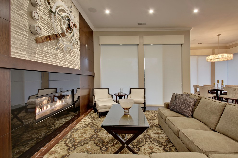 Sleeper Sectional Sofa Living Room Transitional with Chandelier Dining Room Custom Millwork Glass Fireplace Front Led Lighting Linear Fireplace