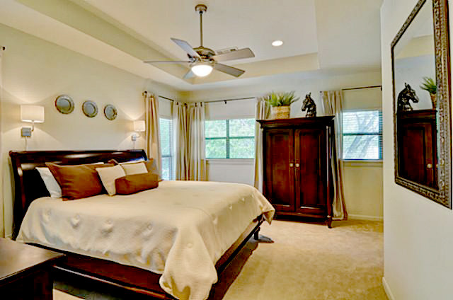 Sleigh Bed King Bedroom Traditional with Armoire Beige Curtain Panels Beige Curtains Bronze Mirror Ceiling Fan Cherry Armoire