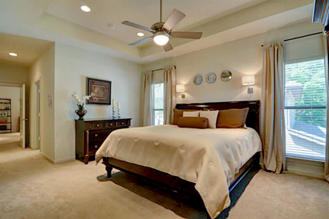 Sleigh Bed King Bedroom Traditional with Armoire Beige Curtain Panels Beige Curtains Bronze Mirror Ceiling Fan Cherry Armoire3
