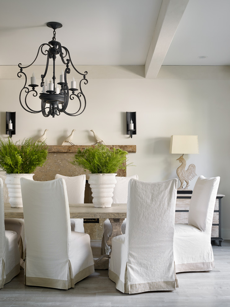 Slipcover Dining Room Transitional with Animal Decor Bird Black Iron Chandelier Exposed Beam Light Potted Plants White