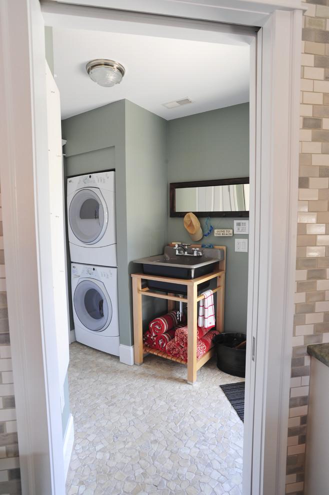 slop sink Laundry Room Transitional with front-loading dryer front-loading waster laundry room mosaic pebble floor stackable washer and