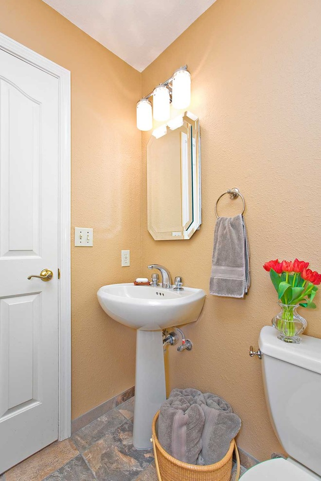 Small Pedestal Sink Bathroom Traditional with Basket Bathroom Mirror Floral Arrangement Pedestal Sink Sconce Stone Flooring Storage Tile