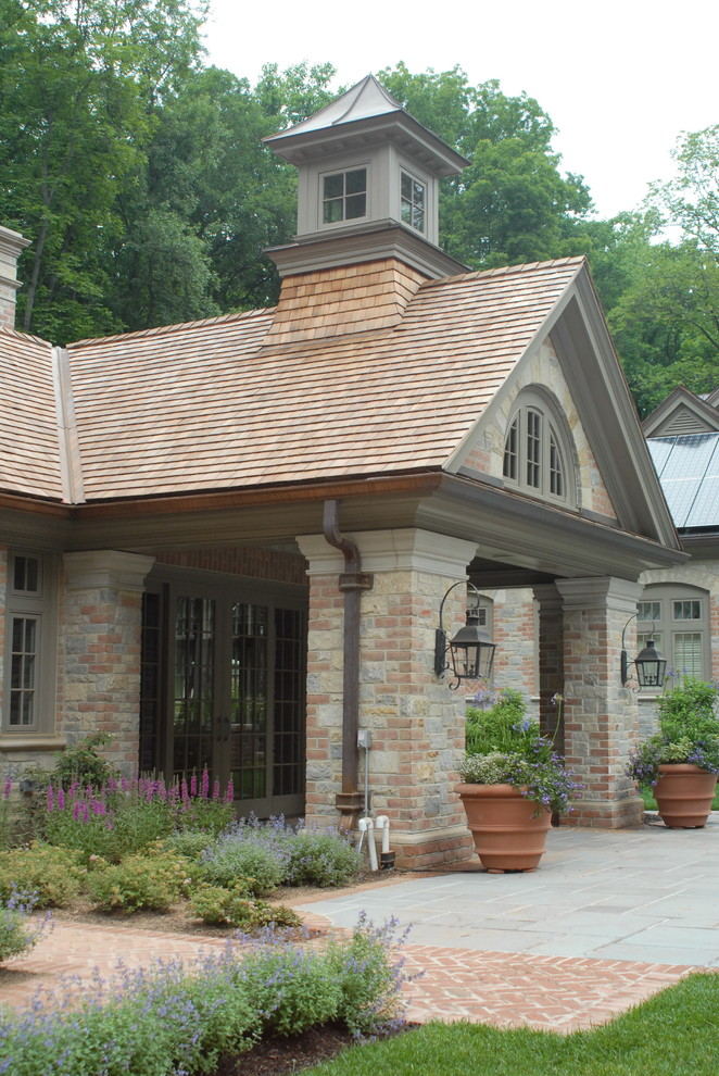 solar lanterns Exterior Traditional with arched windows brick chimney covered entry cupola flagstone french doors gable roof