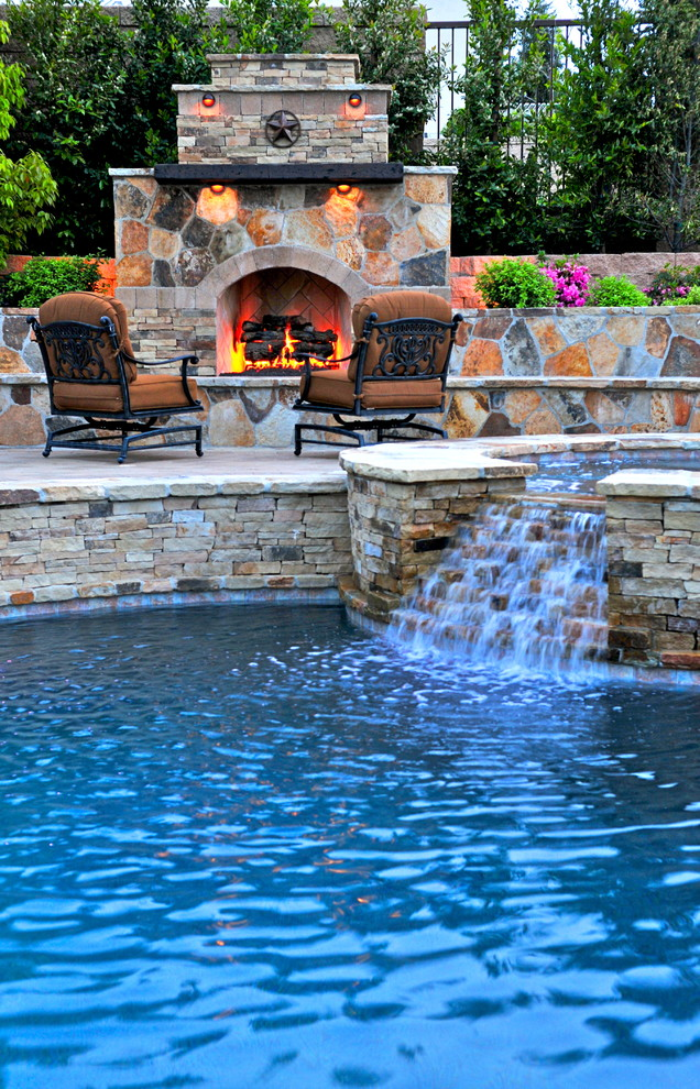 Southern Motion Furniture Reviews Pool Mediterranean with Hot Tub Landscape Outdoor Chair Outdoor Fireplace Patio Furniture Pool Stone Fireplace