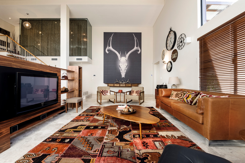 Southwestern Rug Living Room Southwestern with Area Rug Biomorphic Brown Leather Sofa Large Artwork Patchwork Seating Area Statement