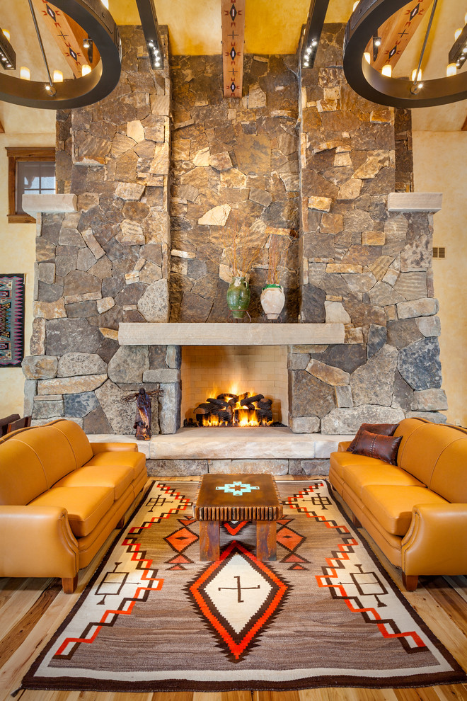 Southwestern Rugs Living Room Southwestern with Brown Leather Pillows Custom Rugs Exposed Beams Fireplace Mantles Iron Light Fixtures