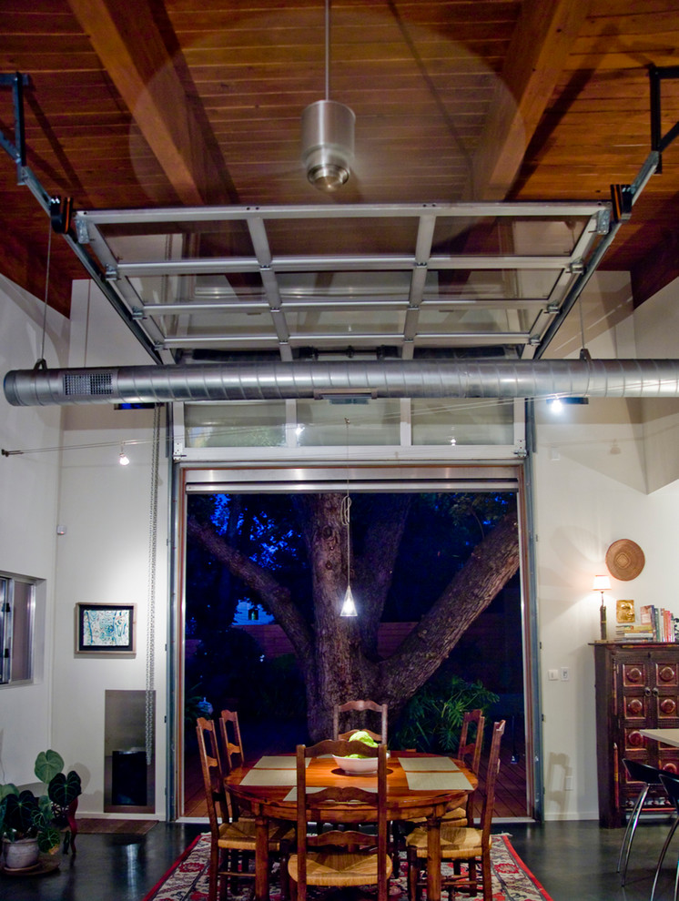 Spring Air Back Supporter Dining Room Industrial with Ceiling Fan Concrete Floor Exposed Duct Garage Door Glass Garage Door Industrial