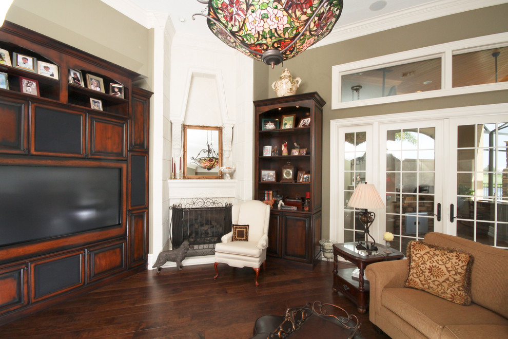 Stained Glass Chandelier Living Room Traditional with Brown Sofa Built in Entertainment Center Corner Fireplace Dark Wood Entertainment Center French