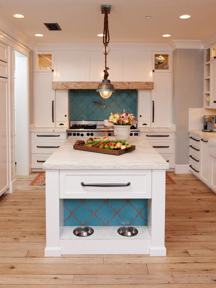 stainless steel bowls Kitchen Mediterranean with centerpiece countertop crown molding dog bowl glass cabinet island l-shaped kitchen pantry