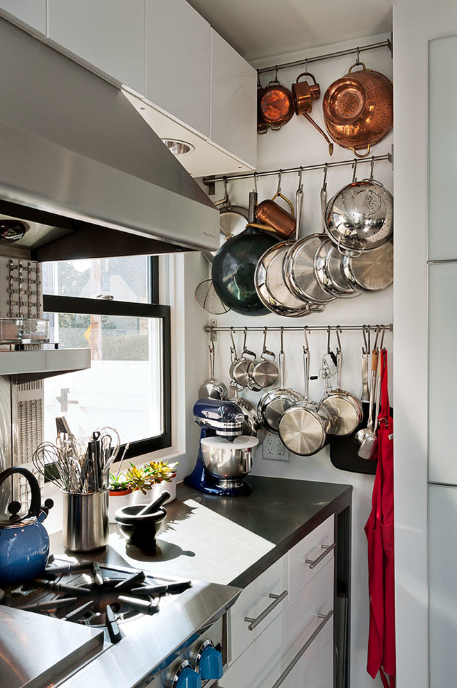 stainless steel frying pan Kitchen Contemporary with bar pulls black counter black windows blue kitchen aid mixer coastal copper