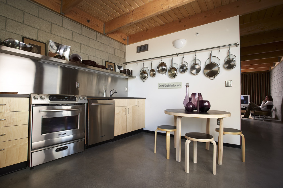 stainless steel roasting pan Kitchen Eclectic with cinder block wall eat in kitchen exposed beams hanging pot rack kitchen