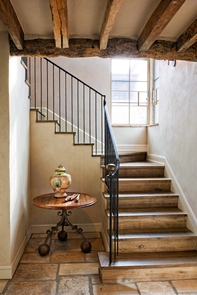 Stair Nose Staircase Rustic with Baseboards Corner Windows Curved Staircase Exposed Beams Rustic Stone Flooring Wood Flooring