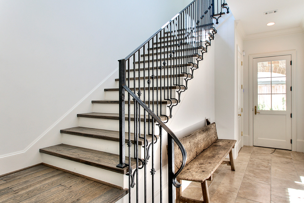Stair Nose Staircase Transitional with Baseboards Entrance Entry Metal Railing Rustic Wood Bench Stair Landing Stone Floors