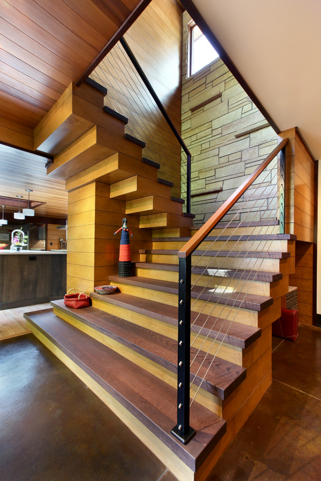stair treads Staircase Rustic with cable railing contemporary earthy modern stacked stone wall wood tongue and groove