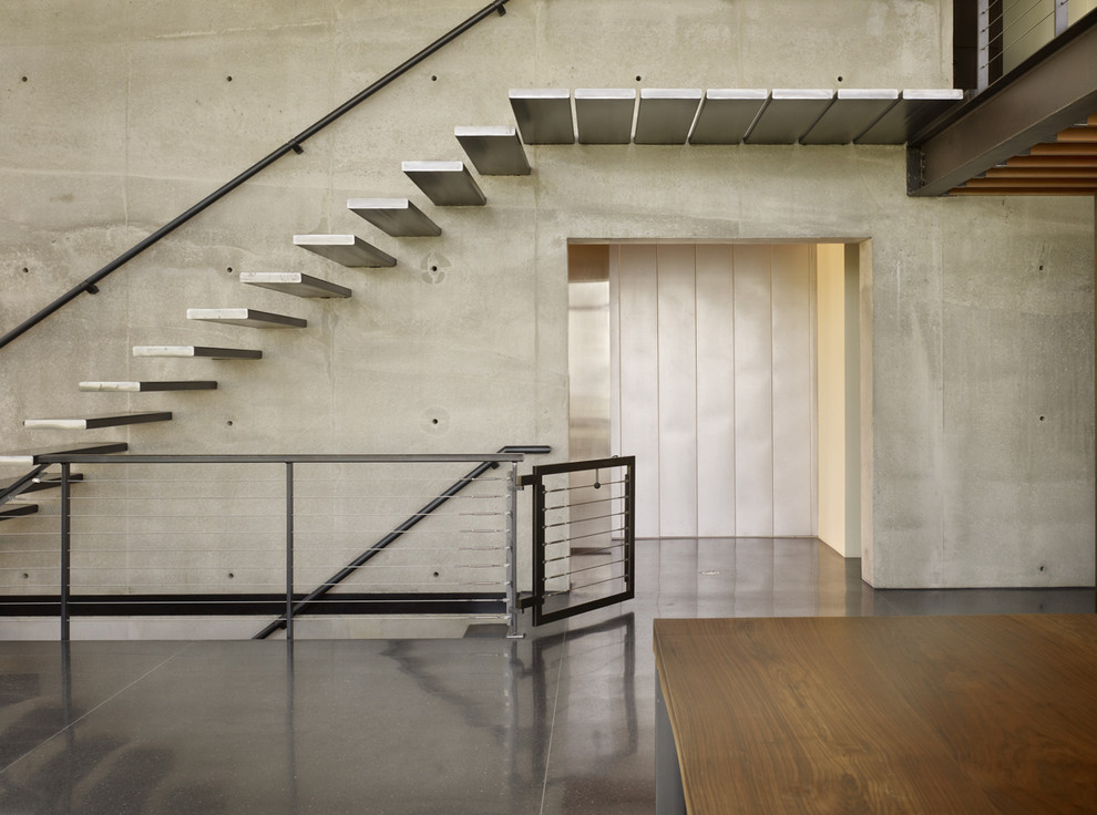 Stairway Gate Staircase Industrial with Black Floor Black Terrazzo Cable Railing Cantilevered Stair Cantilevered Treads Concrete Wall
