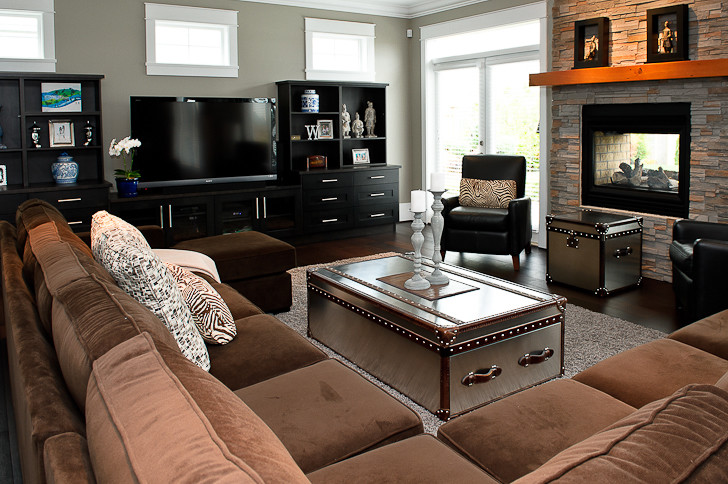 steamer trunk coffee table Living Room Contemporary with brown sectional dark entertainment center dark laminate floors grey shag rig ledgestone