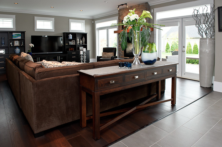 Steamer Trunk Coffee Table Living Room Traditional with Brown Sectional Dark Entertainment Center Dark Laminate Floors Dark Sofa Console Table