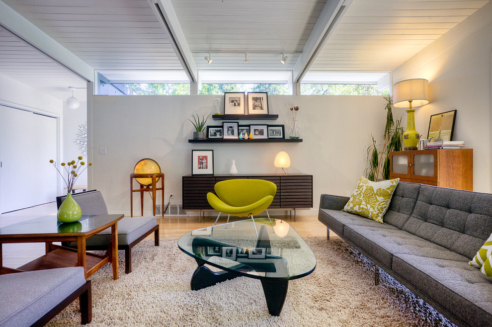Steelcase Leap Chair Living Room Midcentury with Exposed Beams Floating Shelves Glass Coffee Table Green Accent Chair Houseplants Midcentury