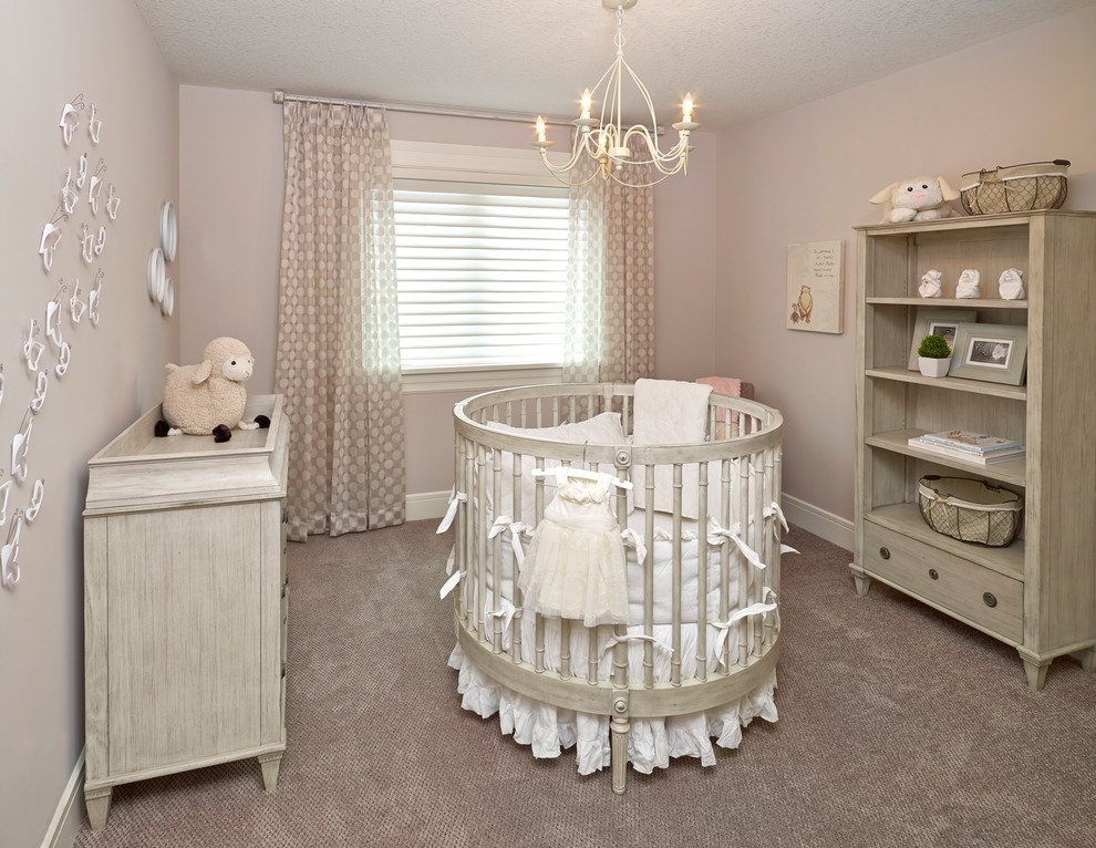 Storkcraft Crib Nursery Transitional with Baseboard Beige Carpeting Chandelier Changing Tables Nursery Round Crib Sheer Curtains Soft
