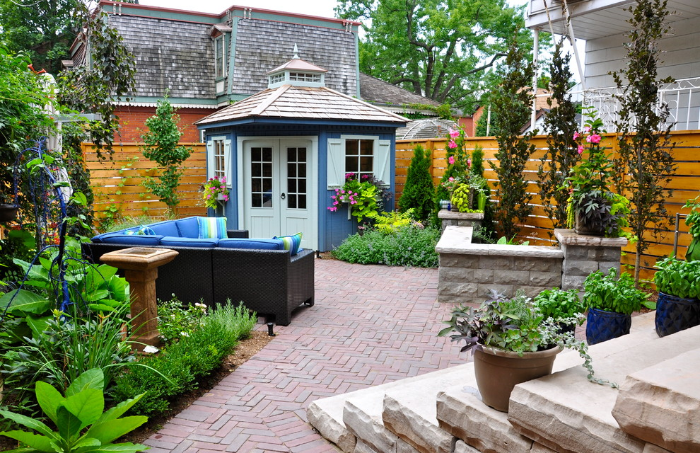 sunbrella umbrella Patio Traditional with back garden backyard bird bath blue shed cedar fence clean lines containers