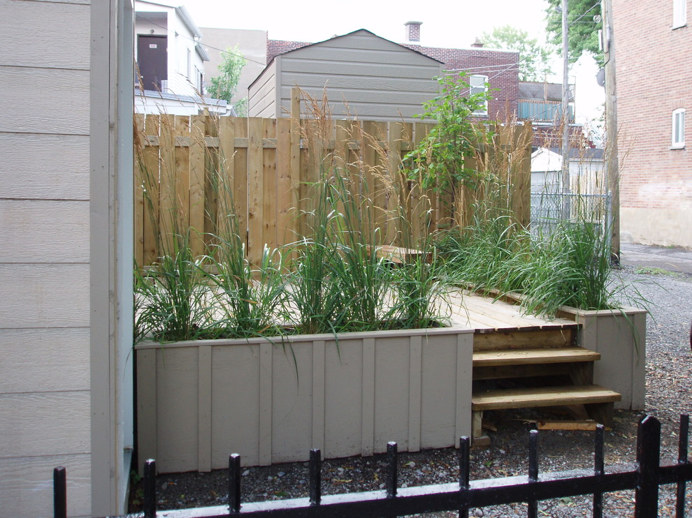 Suncast Deck Box Landscape Contemporary with Board and Batten Deck Gravel Iron Railing Steps Tall Grasses Wood Fence