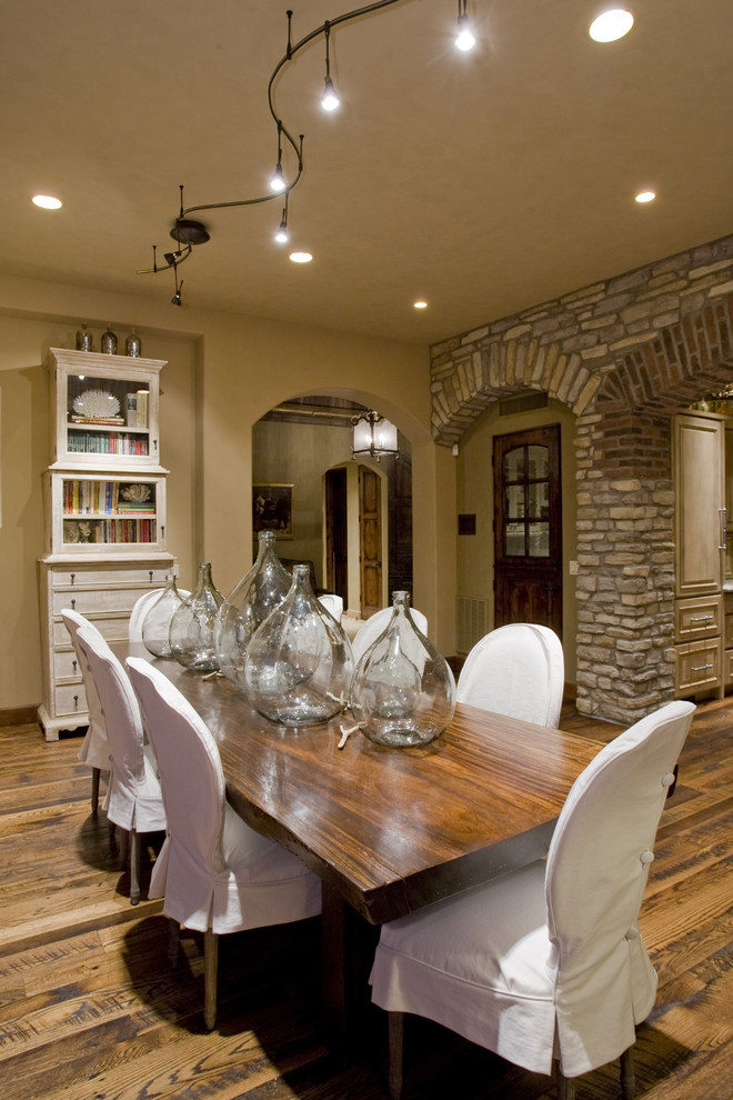 Sure Fit Slipcovers Dining Room Mediterranean with Archway Bottles Glass Front Bookshelf Hardwood Floors Slipcovered Dining Chairs Slipcovers Stone