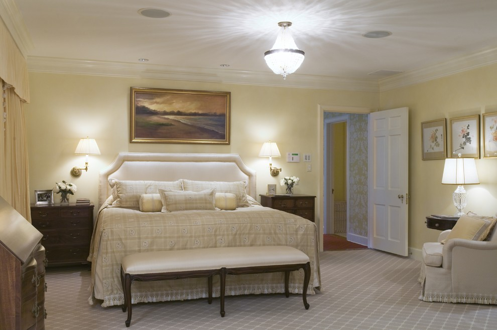 Swing Arm Lamp Bedroom Traditional with Bed Pillows Bedside Table Carpet Pattern Ceiling Lighting Crown Molding Floral Arrangement