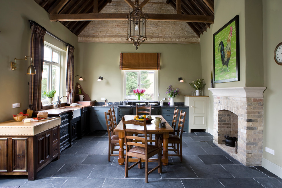Swing Arm Wall Sconce Kitchen Farmhouse with Aga Antiques Belfast Sink in Front of Window Black Kitchen Brick Fireplace