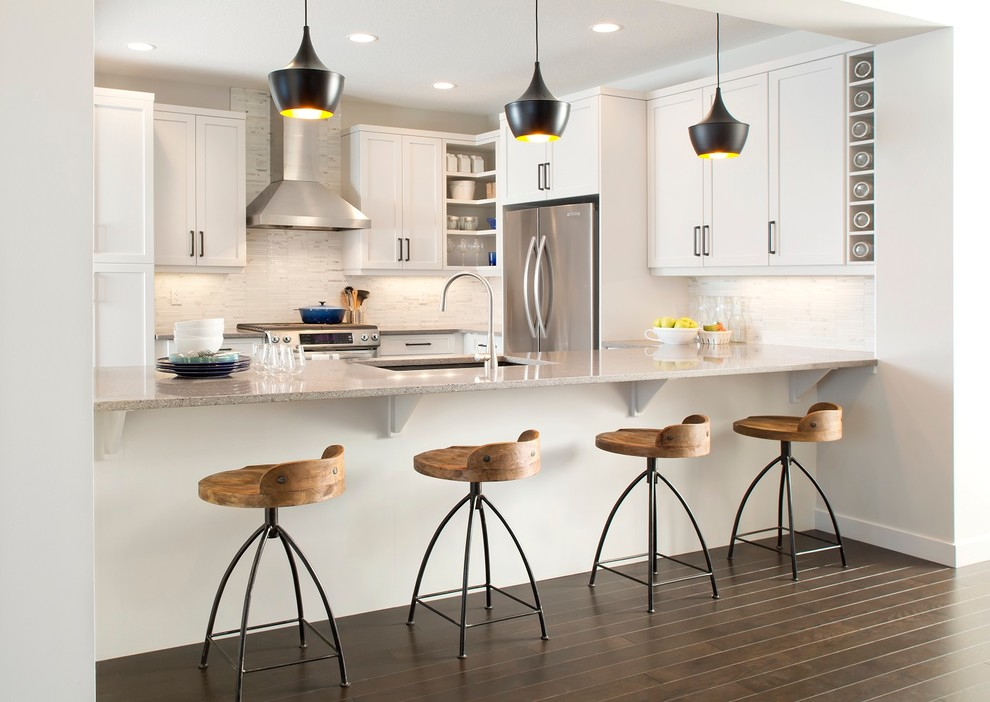 swivel counter stools Kitchen Contemporary with black beat pendant lights blue stockpot frame and panel cabinets hood light