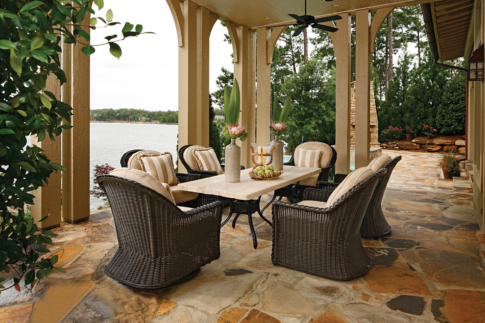swivel glider Patio Traditional with archway beige outdoor cushions beige post ceiling fan covered patio dining chair