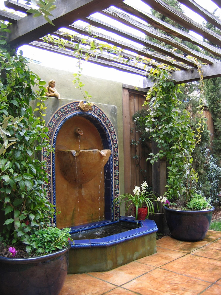 Tabletop Fountain Patio Mediterranean with Accent Tiles Acid Stained Concrete Arbor Backyard Container Plants Fountain Patio Pergola Pond