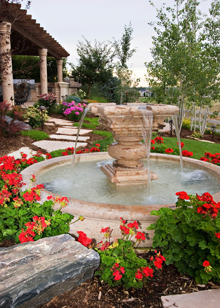 Tabletop Water Fountains Landscape Mediterranean with Fountain Geraniums Grass Lawn Mulch Path Pavers Red Flowers Rocks Turf Walkway