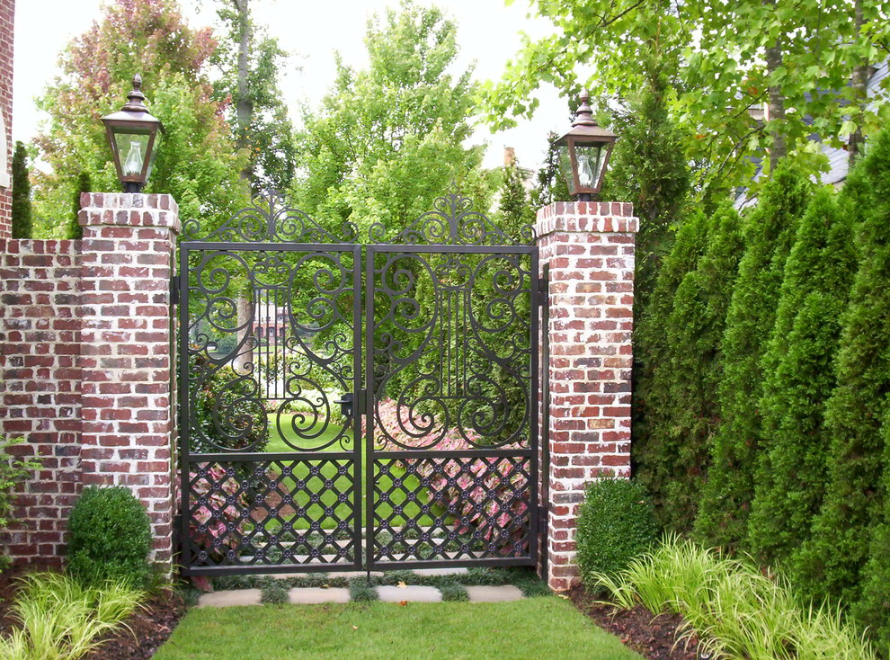 Tall Dog Gates Landscape Traditional with Boxwoods Brick Pillars Cast Stone Balustrade Custom Elegant English Flagstone Flowers Garden
