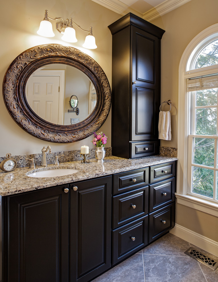 tall linen cabinet Bathroom Traditional with black vanity brushed nickel faucet cream walls drawers framed mirror granite counters