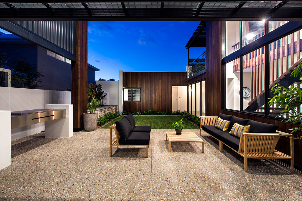 Teak Coffee Table Patio Contemporary with Black Seat Cushions Covered Patio Dark Wood Siding Large Windows Love Seat